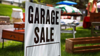 Garage-sale-sign-on-shady-lawn-918x516